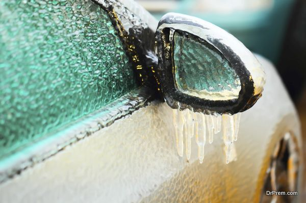 Car side mirror covered with ice