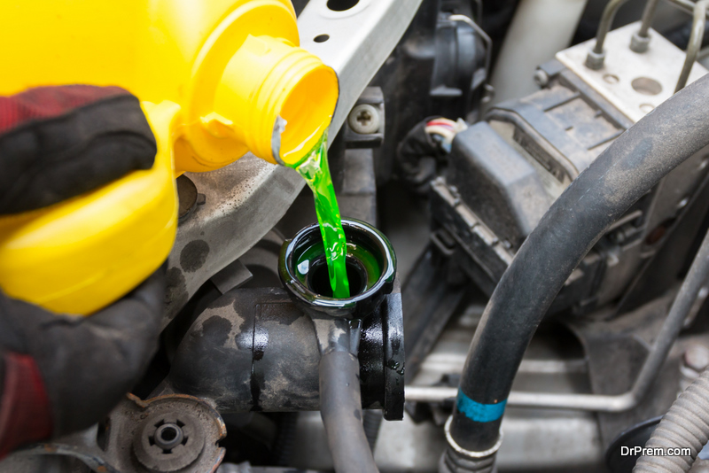 pouring coolant in the vehicle