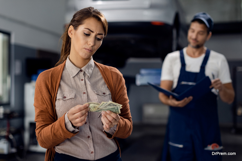 woman-paying-for-repair-or-maintenance-of-the-car